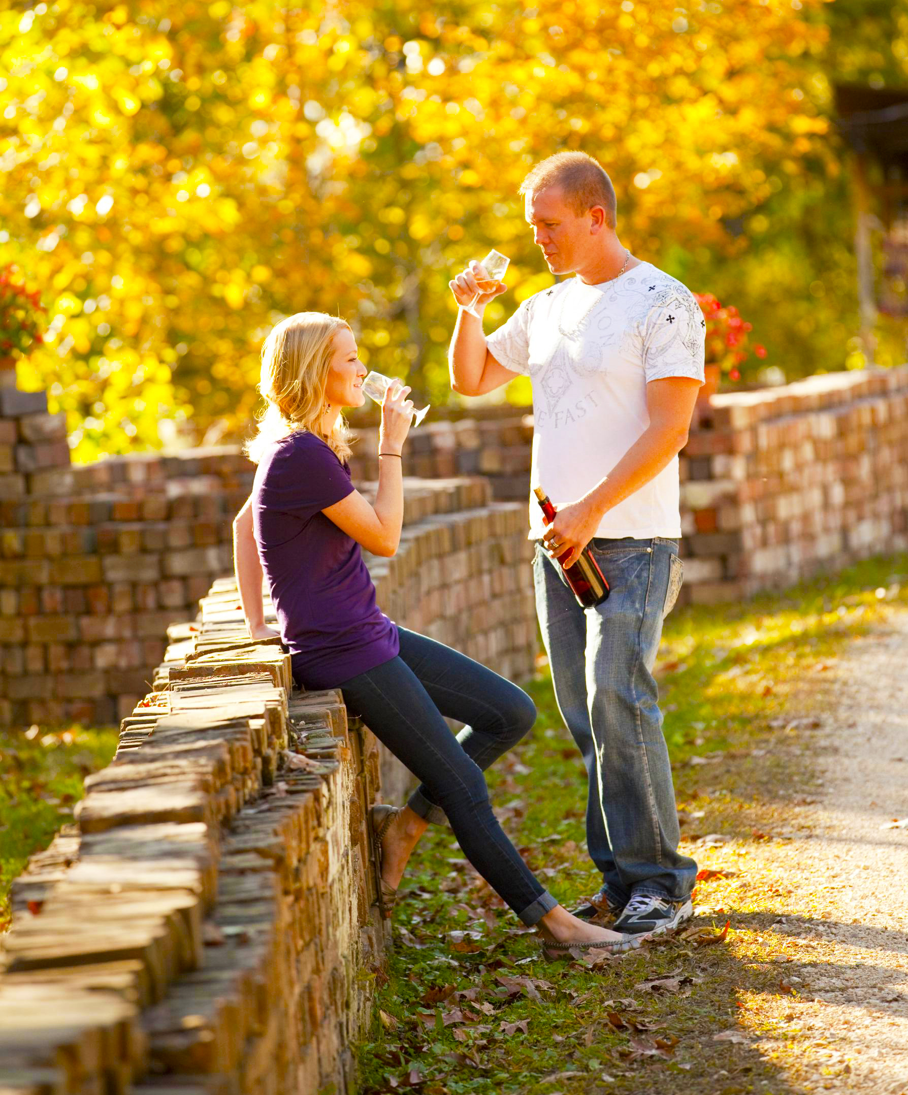 Couples can take their wine out to a deck and onto the grounds at Pomona Winery.