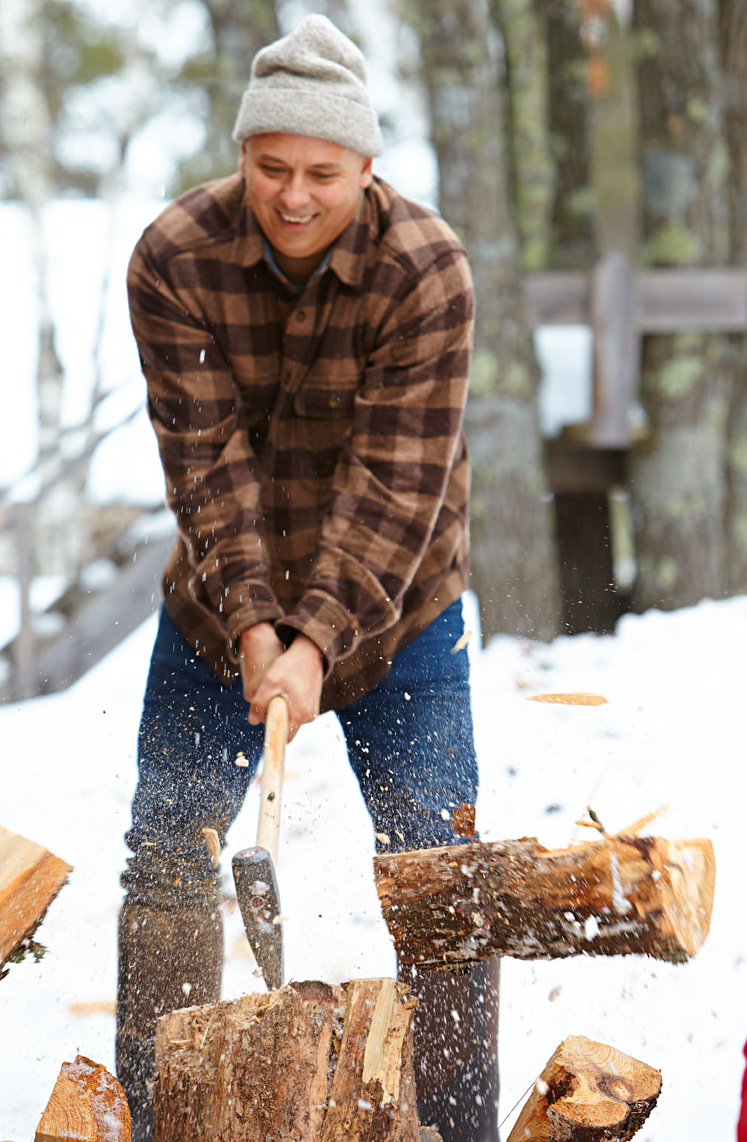 Aaron harvests wood for the stove (and, sometimes, for his artwork) on the 150-acre property