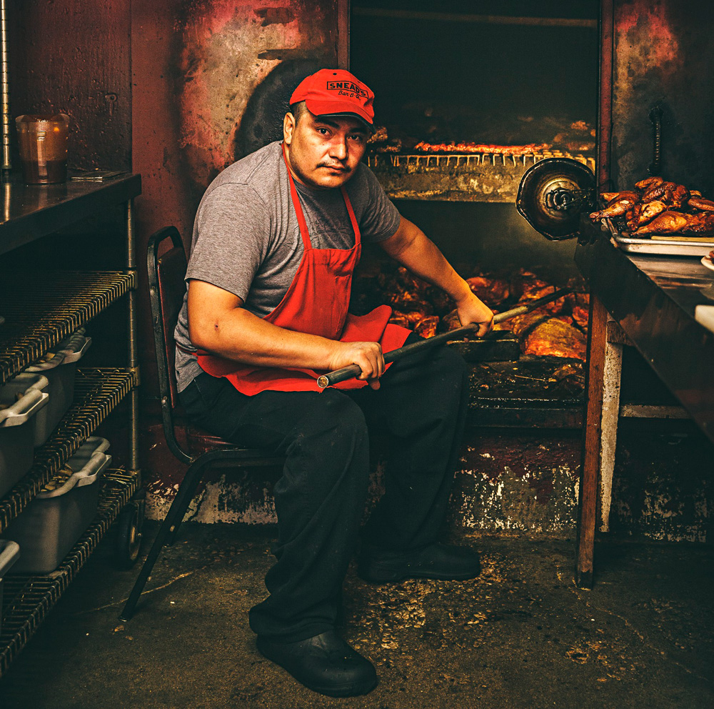 Gumaro tends ribs at Snead's Bar-B-Que's 59-year-old smoke pit in Belton where generations of pit masters have learned the subtleties of keeping the pit's heat perfect through varying temperatures, humidity and wind.