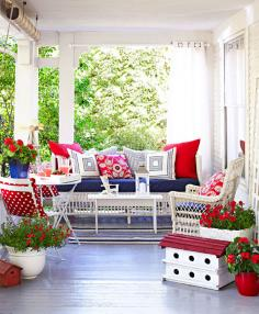 "An ""entryway"" of potted plants leads to furniture arranged for conversation, creating the sense  of a special retreat on a large porch."