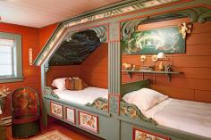 Guests sleep in hand-painted cupboard beds at Trestuen Gallery and Studio in Milan, Minnesota.