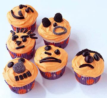 orange and black faces keep it simple by decorating cupcakes - Halloween Decorations Cupcakes