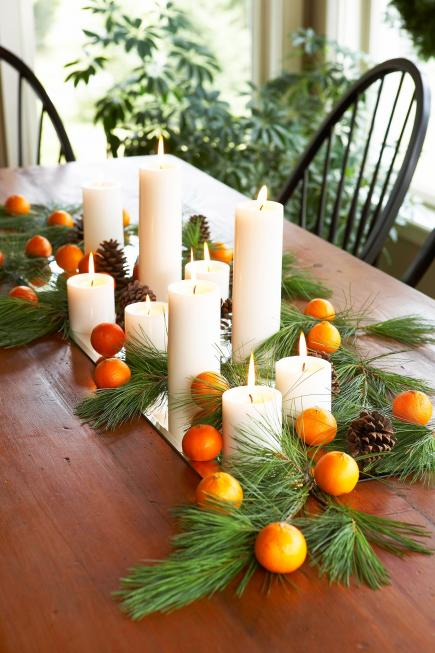 50 easy christmas centerpiece ideas midwest living christmas centerpiece ideas fruit and candles solutioingenieria Images