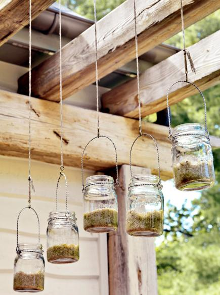Mason jars above outdoor dining area