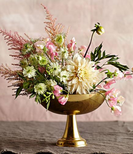 Lushly layered flower arrangement