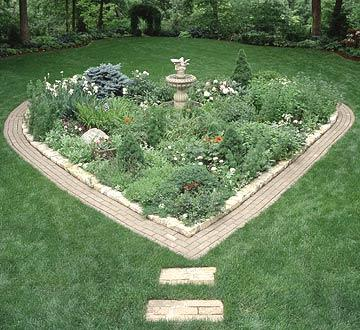A lighthearted garden heart shape plants midwest living for Flower bed shapes designs