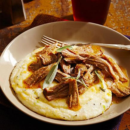 A slice of comfort 50 favorite recipes midwest living milk braised pork with cheesy grits forumfinder Gallery