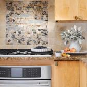 Quick and Easy Kitchen Backsplash Updates | Midwest Living on natural stone behind cooktop, breakfast bar behind cooktop, backsplash above cooktop, tile on wall behind cooktop, backsplash ideas, stainless steel behind cooktop, tile design behind cooktop,