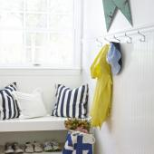 A mudroom with striped accents