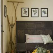 A rustic bench adds character to a mudroom.
