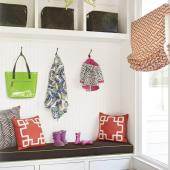 Mudroom with a chandelier.