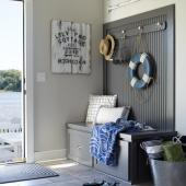 A gray mudroom with nautical touches.