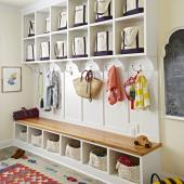 Mudroom uses canvas tote bags as storage.