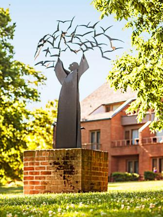 """The sculpture """"St. Francis and the Birds"""" at the New Harmony Inn."""