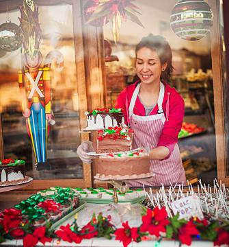Buttercream-topped cakes fill the window at Kirschbaum's Bakery in Western Springs.