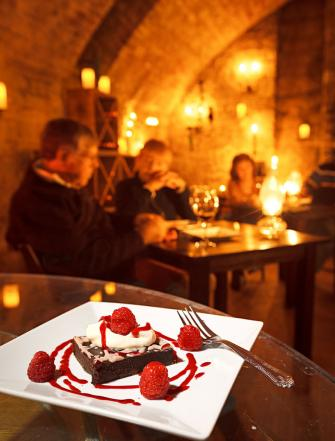 Dessert and port in the cellar at Alpenhorn Gasthaus in Hermann set a romantic tone.