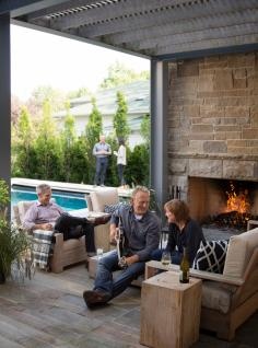 Lisa Sablosky wasn't even sure she wanted the fireplace on the three-season patio. Now when friends visit, it's a favorite spot for a glass of wine—and the occasional guitar riff.
