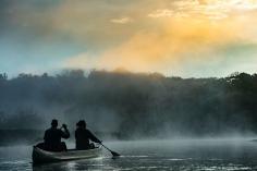 Paddlers explore the Upper Iowa River.