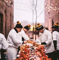 Chefs prep a four-course dinner in the street during The Great Northern's first celebration last year.