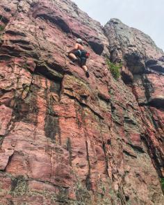 Amanda tackles Blue Mound State Park's 100-foot Sioux quartzite cliff